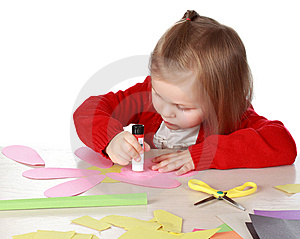 child-with-bits-of-paper